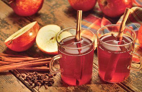 Hot apple cider with cinnamon sticks