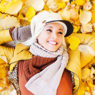 Beautiful woman enjoying in a sunny autumn day.