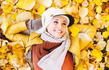 Beautiful woman enjoying in a sunny autumn day.